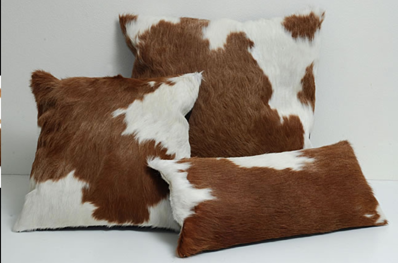 - Natural Cowhide Rugs - <br> (prices on request)